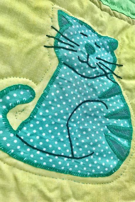 Cute hand stitched baby quilted cover or play mat.