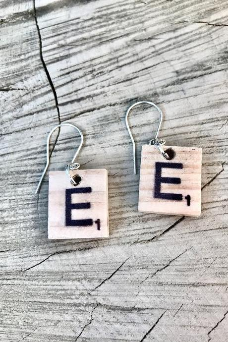 Sweet little wooden scrabble letter earrings.